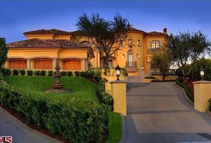 Mediterranean Exterior of Home with Fence, French doors, Pathway, Arched window