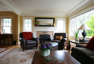 Traditional Living Room with stone fireplace, Standard height, Crown molding, picture window, Casement, Fireplace