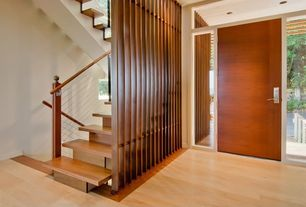 Contemporary Staircase with High ceiling, Hardwood floors