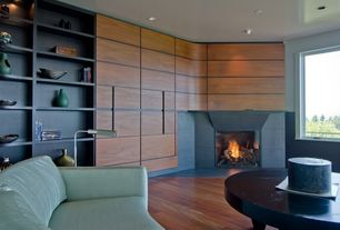 Contemporary Living Room with Built-in bookshelf, Hardwood floors