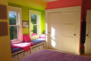 Contemporary Kids Bedroom with Three panel sliding door, Window seat, Carpet, Crown molding