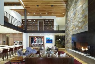 Contemporary Great Room with High ceiling, stone fireplace, Loft, Hardwood floors
