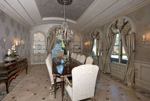 Traditional Dining Room with stone tile floors, Casement, Crown molding, Wall sconce, can lights, Standard height, Chandelier