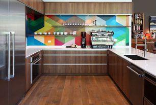 Modern Kitchen with Flush, corian, Solid Surface Countertop Sample in Glacier White, walnut veneer, Hardwood floors, U-shaped