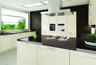 Modern Kitchen with Concrete tile , Skylight, U-shaped, Island Hood, double wall oven, Standard height, can lights, Flush