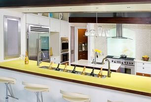 Contemporary Kitchen with built-in microwave, Corian Designer White Solid Surface, Framed Partial Panel, Island Hood, Paint 1