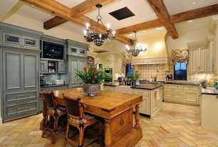 Traditional Kitchen with Simple granite counters, Large Ceramic Tile, full backsplash, wall oven, Casement, Breakfast bar