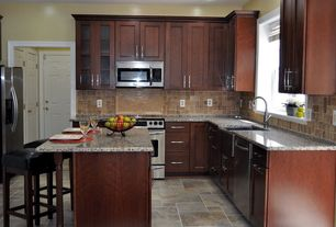 Traditional Kitchen with Kitchen island, Flat panel cabinets, Stone Tile, Simple granite counters, Undermount sink