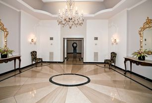 Traditional Entryway with Crown molding, complex marble floors, Wall sconce, Wainscotting, Chandelier, Standard height