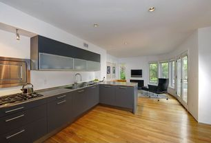 Contemporary Kitchen with electric cooktop, Flush, can lights, Glass panel door, specialty window, L-shaped, Glass panel