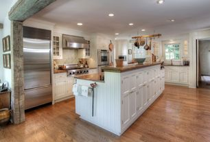 Country Kitchen with Crown molding, double-hung window, Glass panel, Inset cabinets, built-in microwave, electric cooktop