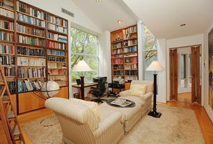 Traditional Library with Built-in bookshelf, Hardwood floors
