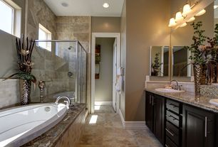 "Traditional Master Bathroom with American Standard Ellisse 69"" x 38.5"" Oval Bathtub, Double sink, Raised panel, Stone Tile"