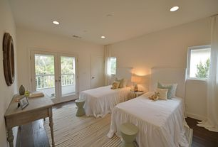 Contemporary Guest Bedroom with Hardwood floors, French doors