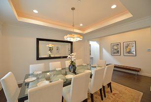Modern Dining Room with Hardwood floors, Carpet, Chandelier