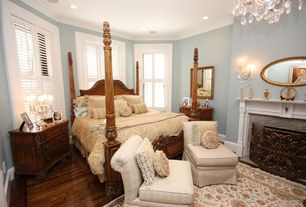 Traditional Guest Bedroom with Chandelier, Hardwood floors, Crown molding