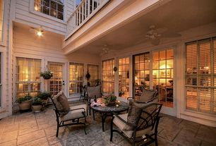 Traditional Patio with Pottery Barn Umbria Planters, exterior stone floors, Raised beds, French doors