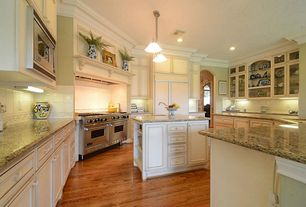 Traditional Kitchen with Standard height, Flat panel cabinets, Hardwood floors, Built-in bookshelf, U-shaped, Onyx