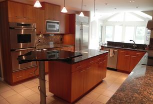 Modern Kitchen with Pendant light, European Cabinets, Dura Supreme Cabinetry Camden Panel, Simple granite counters, U-shaped