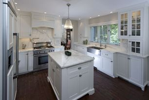 Traditional Kitchen with Complex marble counters, Laminate floors, U-shaped, Dura Supreme Cabinetry Hanover Panel