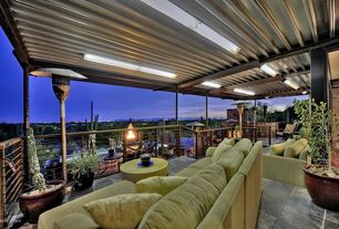 Contemporary Patio with Raised beds, exterior stone floors, Deck Railing