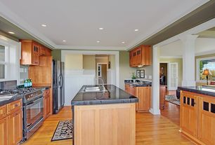 Craftsman Kitchen with Columns, Wainscotting, Hardwood floors, Glass panel, Flat panel cabinets, Crown molding, U-shaped
