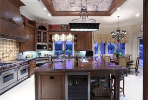 Traditional Kitchen with Concrete floors, 38-bottle stainless steel wine refrigerator, Breakfast nook, Raised panel