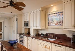 Traditional Kitchen with Hardwood floors, Raised panel, Kitchen island, Ceiling fan, Wood counters, One-wall, High ceiling
