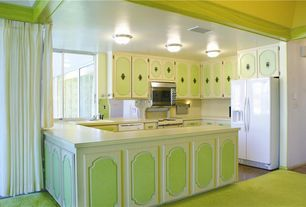 Eclectic Kitchen with Concrete floors, Raised panel, Rainbow 141 lime green carpet, L-shaped, Kitchen peninsula, flush light