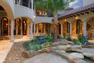 Mediterranean Landscape/Yard with French doors, exterior stone floors, Arched window