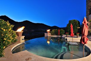 Contemporary Swimming Pool with Raised beds, exterior stone floors, Fire pit, Infinity pool