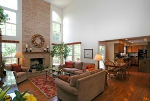 Country Living Room with Carpet, brick fireplace, Cathedral ceiling, double-hung window, Hardwood floors, can lights