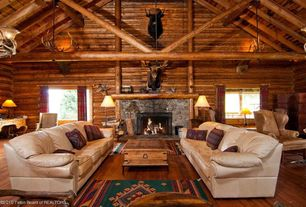 Rustic Living Room with stone fireplace, Exposed beam, Cathedral ceiling, Carpet, Hardwood floors, Chandelier