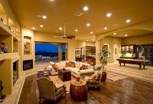 Eclectic Living Room with Ceiling fan, Standard height, Hardwood floors, can lights, Carpet