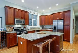 Traditional Kitchen with Raised panel, Polished granite counter tops, Complex Granite, Simple Granite, Bamboo floors