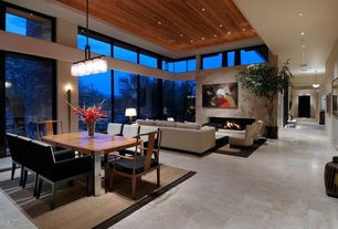 Modern Great Room with Chandelier, High ceiling, picture window, can lights, Modern dining chairs, other fireplace, Fireplace