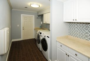 Contemporary Laundry Room with Hardwood floors, Built-in bookshelf, Undermount sink, laundry sink, Standard height