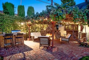 Traditional Patio with picture window, Outdoor bar, Trellis, Outdoor kitchen, exterior brick floors, outdoor pizza oven