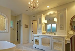 Traditional Master Bathroom with Undermount sink, Wall sconce, Concrete tile , can lights, Casement, Bathtub, Inset cabinets