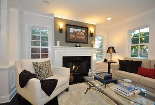 Contemporary Living Room with Columns, metal fireplace, Concrete floors, Wall sconce, Crown molding