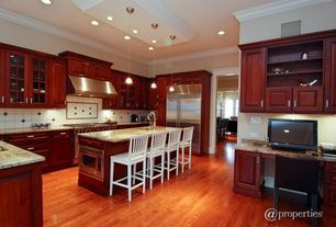 Craftsman Kitchen with Large Ceramic Tile, High ceiling, Laminate floors, Raised panel, Pendant light, Crown molding