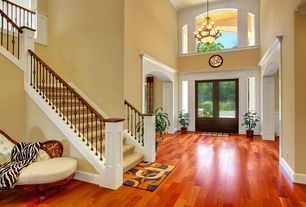 Modern Entryway with Cathedral ceiling, French doors, 19j07v brazilian cherry natural, flush light, Hardwood floors
