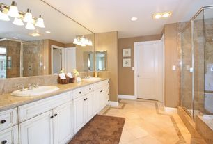 Mediterranean Master Bathroom with Wall sconce, SONOMA BATH LIGHT - THREE LIGHTS, Daltile Limestone in Euro Beige, Frameless