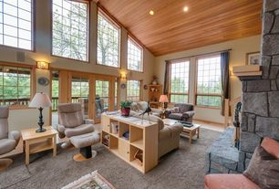 Rustic Living Room with Hardwood floors, Natural light, French doors, Mount Saint Helens Limestone, Natural stone fireplace