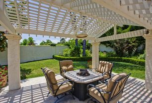Traditional Patio with Fence, Trellis, exterior stone floors, Fire pit