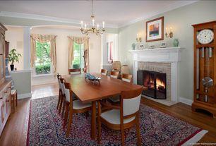 Eclectic Dining Room with Laminate floors, Crown molding, Chandelier, Carpet, specialty door