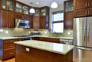 Contemporary Kitchen with Complex granite counters, Kitchen island, Glass panel, L-shaped, Glass Tile, Undermount sink