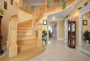 Traditional Staircase with High ceiling, simple marble floors, Wall sconce, curved staircase