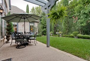 Traditional Patio with Glass panel door, Fence, Trellis, exterior tile floors