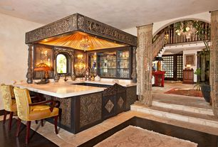 Eclectic Bar with stone tile floors, can lights, Standard height, Hardwood floors